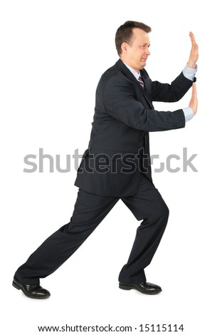 businessman rests hands against wall, push somthing