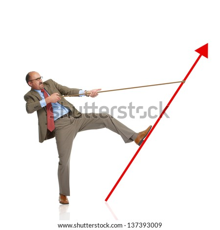 Businessman retain a rising arrow, representing business growth - stock photo