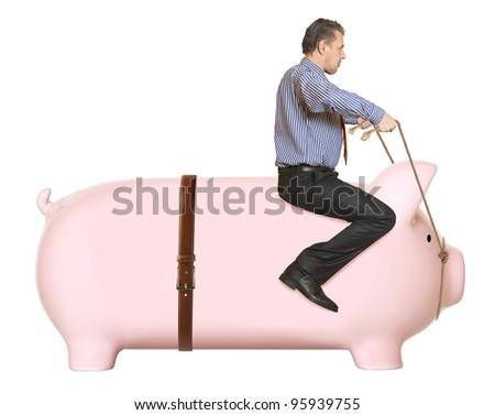 Businessman riding a piggy bank. Concept - stock photo