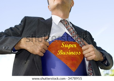 Businessman ripping his white shirt open to reveal he is a super businessman - stock photo
