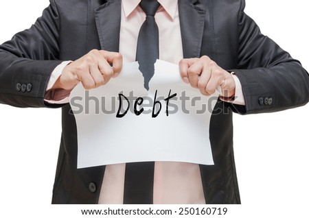 Businessman ripping up the Debt sign on white background - stock photo