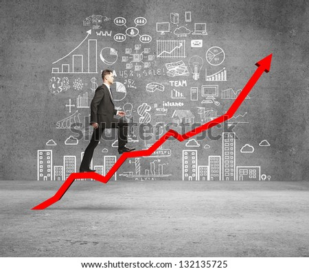 businessman rise on chart and drawing concept on wall - stock photo