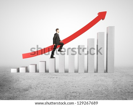 businessman rises up on business diagram - stock photo