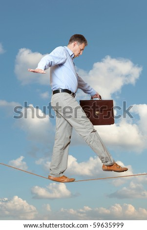 Businessman rope-walker - stock photo