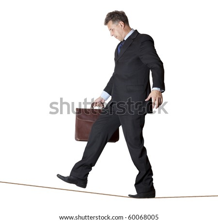 Businessman rope-walker. Isolated on white background - stock photo