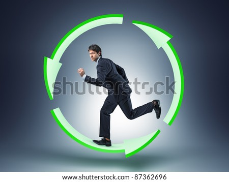 businessman run in recycle circle - stock photo