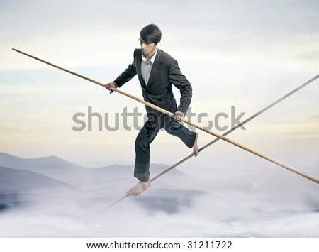 Businessman running a tightrope - stock photo
