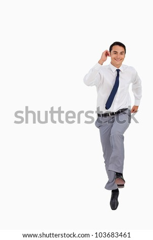 Businessman running against white background