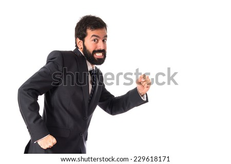 Businessman running fast over white background - stock photo