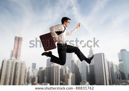 Businessman running fast with cityscape in the background - stock photo