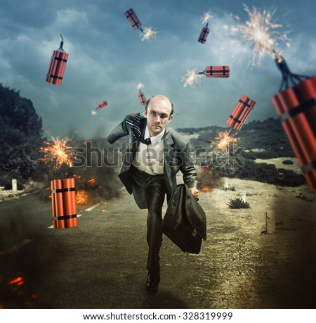 Businessman running from dynamite exploding on the road - stock photo