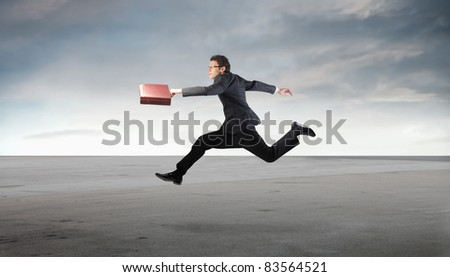 Businessman running in a desert - stock photo