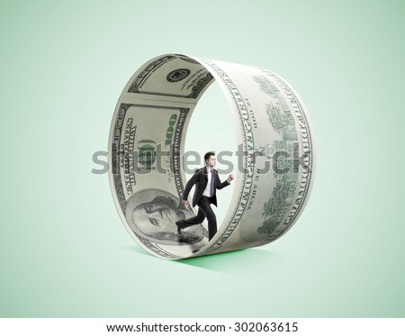 businessman running in money wheel  on green background - stock photo