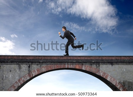 Businessman running on a bridge