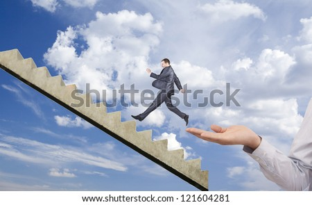 businessman running on hand manipulator boss - Symbol of the interview, the applicant, job search, business trip, start, help, begin, flying, lightness, levity, protege, protegee, insurance, belay - stock photo