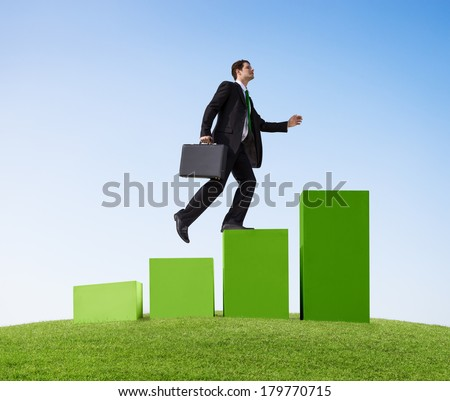 Businessman Running up Green Bar Graph Outdoors - stock photo