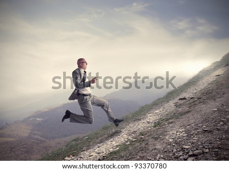 Businessman running uphill - stock photo