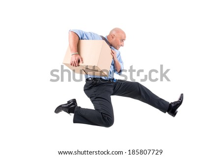Businessman running with cardboard boxes - stock photo