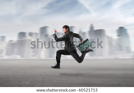 Businessman running with cityscape on the background - stock photo