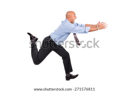 Businessman running with raised arms chasing, isolated in white