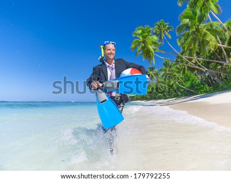 Businessman Running with Snorkel on Paradise Beach - stock photo