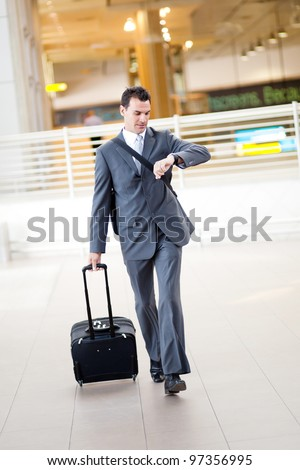 businessman rushing in airport to catch a flight