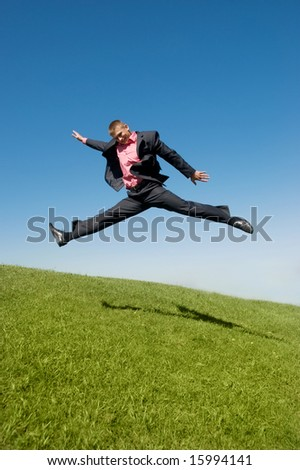 businessman rushing to work against blue sky