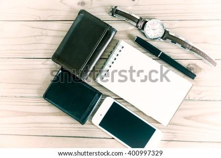 businessman's accessories, notepaper, pen, wristwatch, wallet, smart phone-, vintage style - stock photo