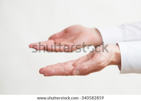 Businessman's empty palms, neutral background