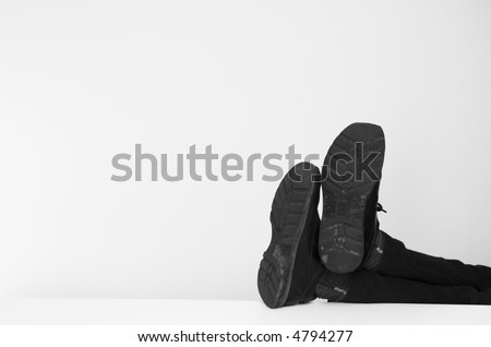 Businessman's feet up on his desk. - stock photo