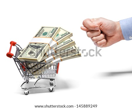 businessman's fig & steel grocery cart full of money stacks / man's hand shows the fig to a cart full of money stacks - isolated on white background  - stock photo