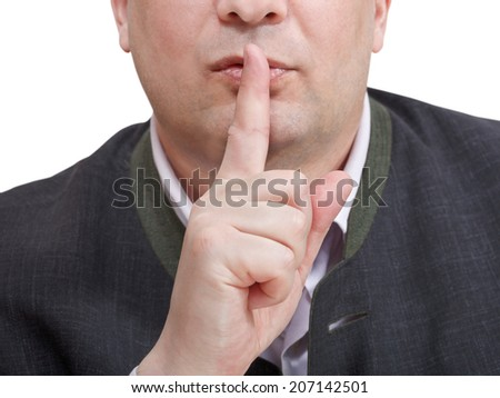 businessman's finger near lips - silence hand gesture isolated on white background - stock photo