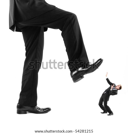 Businessman's foot stepping on tiny businessman - stock photo