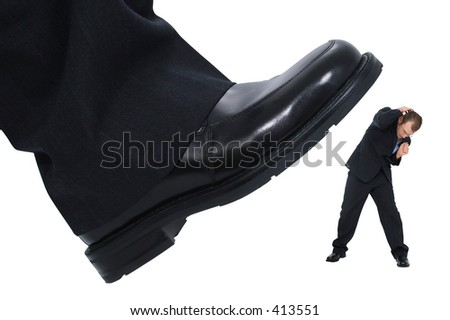 "Businessman's foot stepping on tiny businessman.  Metaphor for ""Crushing the Competition"" ""Squashing the Little Guy"" or for at work stress or power. - stock photo"