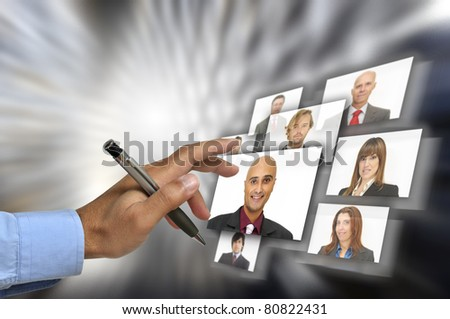 Businessman's hand choosing employees with modern technology