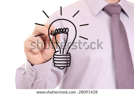 Businessman's hand drawing light bulb on white-board - stock photo