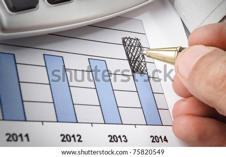 Businessman's hand drawing on diagram to grow - stock photo