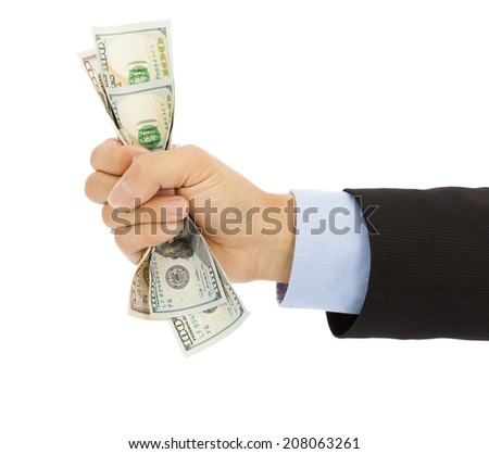 businessman's hand grasping a handful of dollars