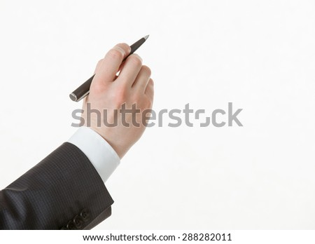Businessman's hand holding a pen, white background - stock photo
