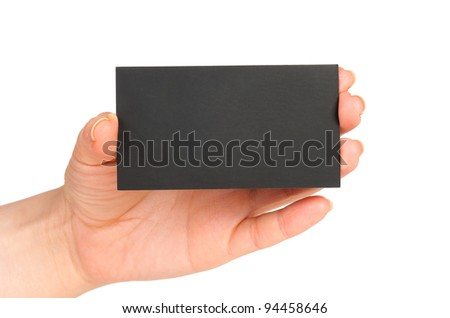 Businessman's hand holding blank black paper business card, closeup isolated on white background - stock photo