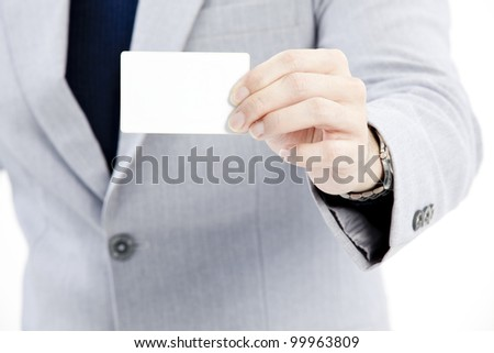Businessman's hand holding blank paper business card - stock photo
