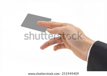 Businessman's hand holding blank paper business card on white background
