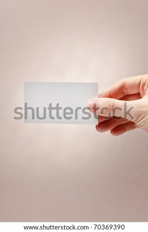businessman's hand holding blank white paper business card - stock photo