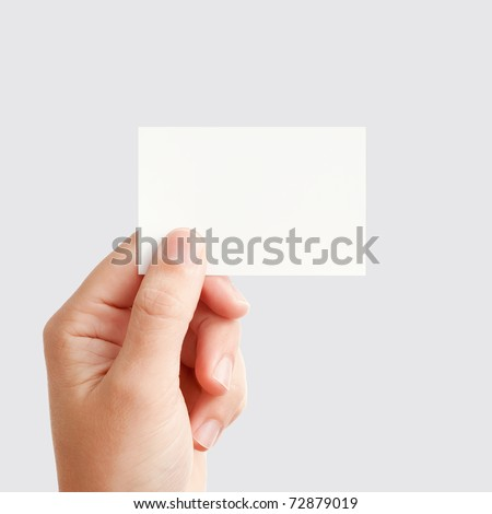 Businessman's hand holding blank white paper business card, closeup isolated on square gray background - stock photo