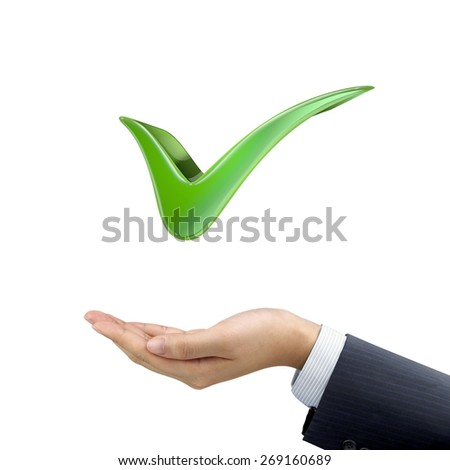 businessman's hand holding check mark over white background - stock photo