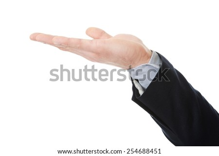 Businessman's hand holding copyspace on palm. - stock photo