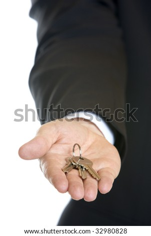 businessman's hand holding key in hand ready for handing over - stock photo