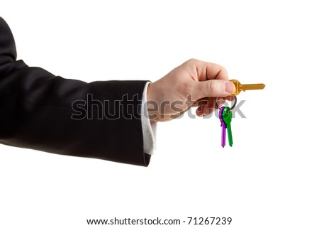 Businessman's Hand Holding Key isolated on white