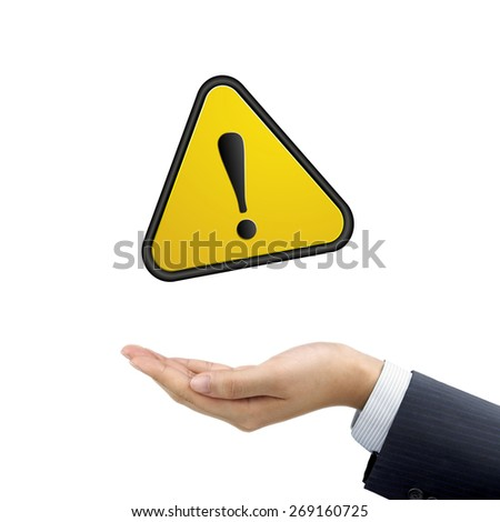 businessman's hand holding warning sign over white background - stock photo