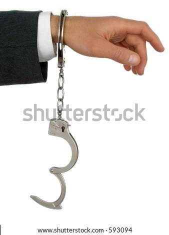 Businessman's Hand In Handcuffs - stock photo